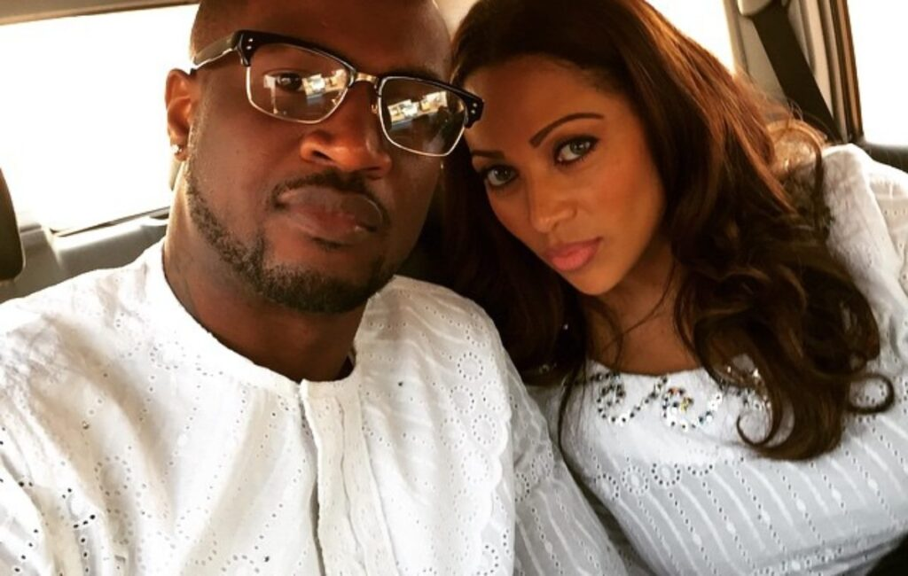 Peter Okoye's wife, Lola Omotayo puffs on a cigarette as they party together