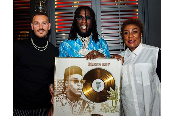 Burna Boy receives a plaque after his song, 'On The Low' went Gold In France