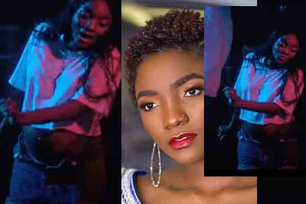 Pregnant Simi shows off babybump in new music video