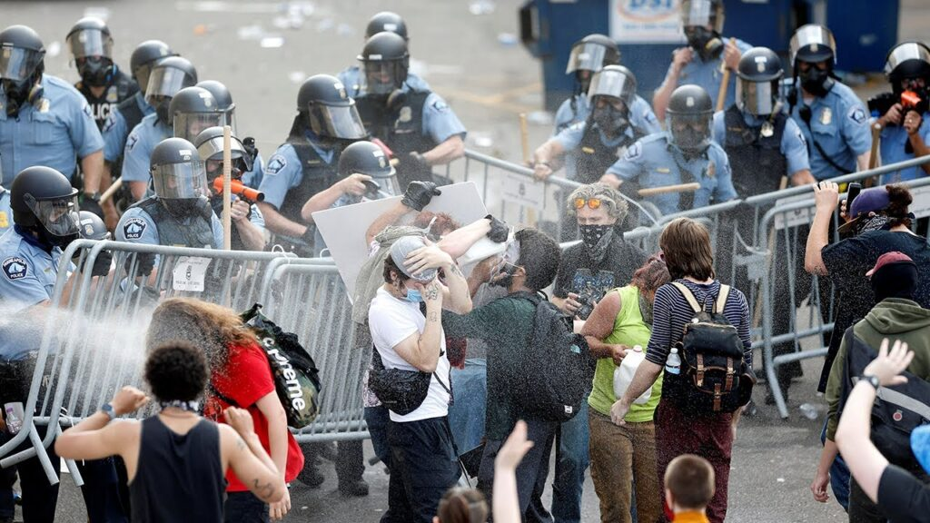 George Floyd death: Protesters and riot police clash in Minneapolis