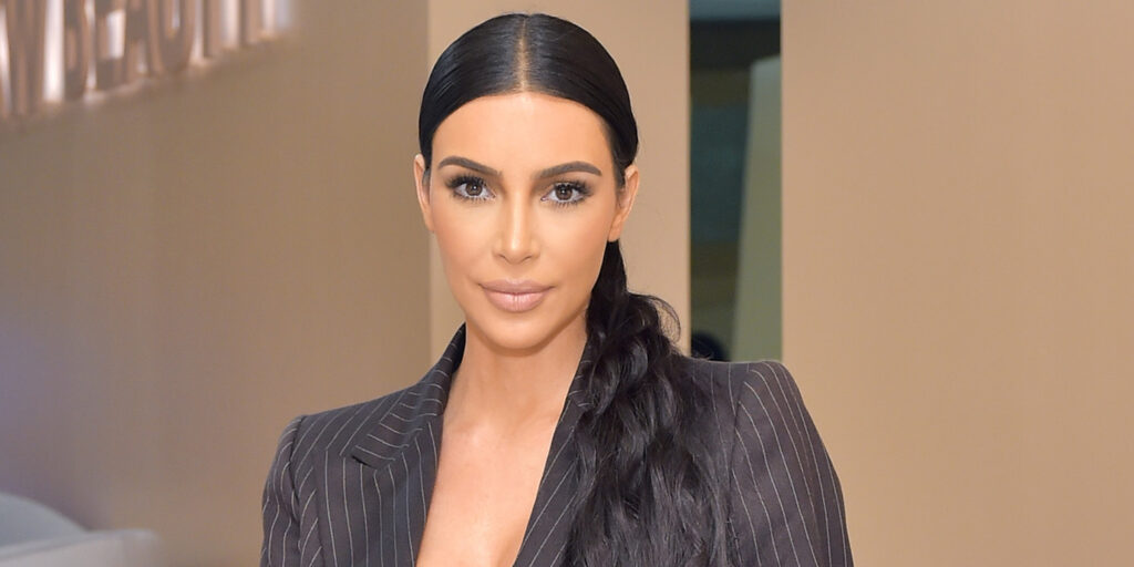 Kim Kardashian celebrates 170 Million Instagram followers by releasing new photos of her in a figure hugging, cleavage-baring, low-cut dress